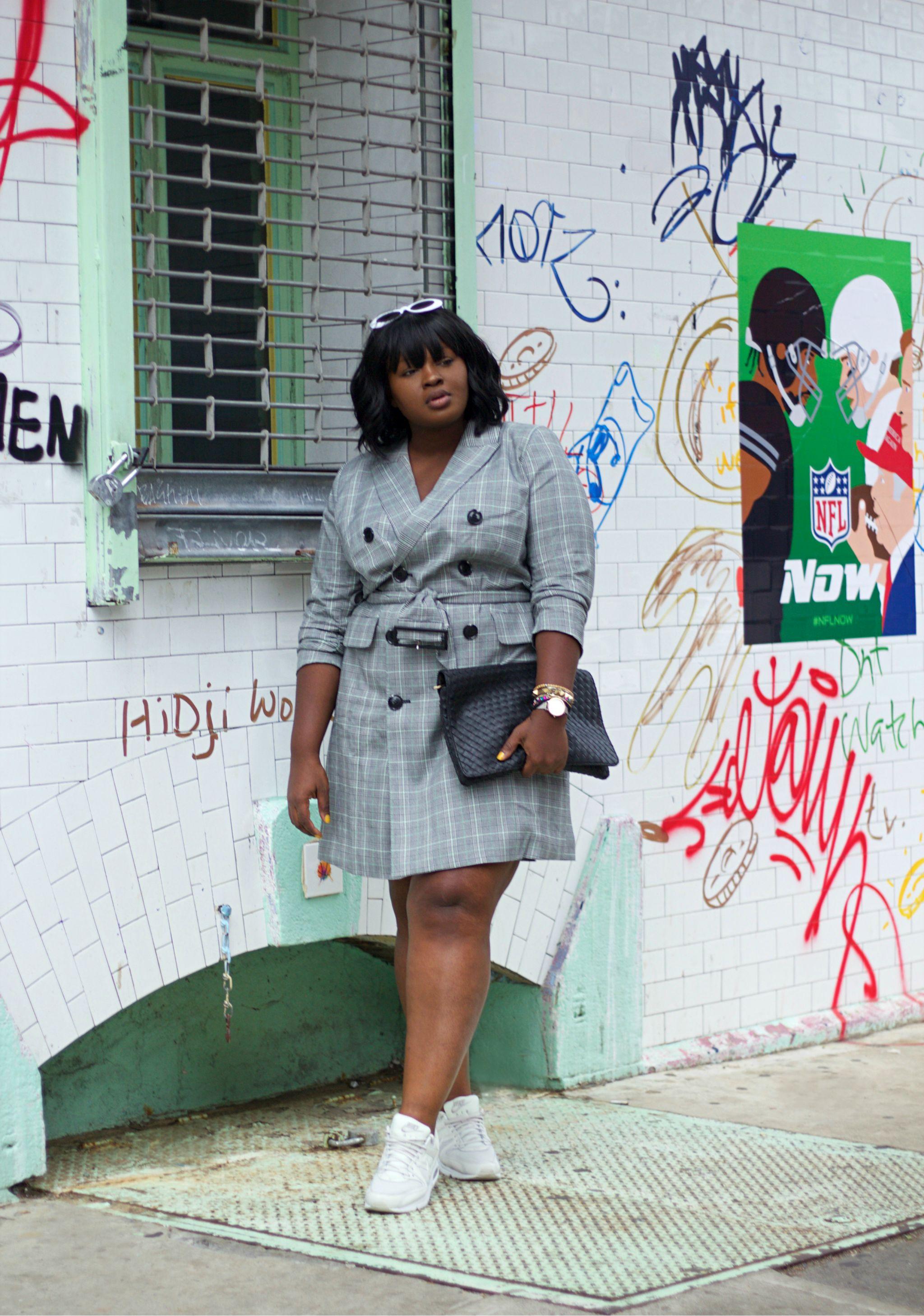 Plaid dress and black clutch NYFW